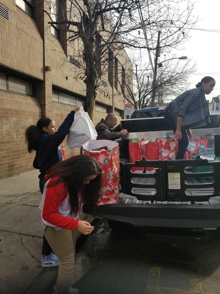 Mr intronas truck being loaded by student council members