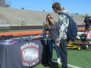 A student talks with a representative from Middleville Tool & Die.