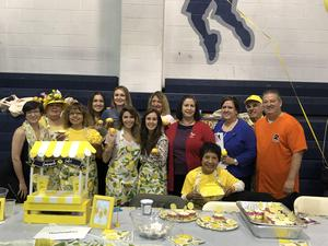 Washington School staff at their lemonade display table with Mrs. Abbato, principal Rivera, & Mrs. Birne