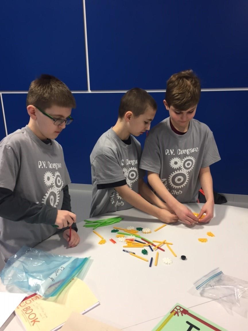 Students constructing a model using K'Nex