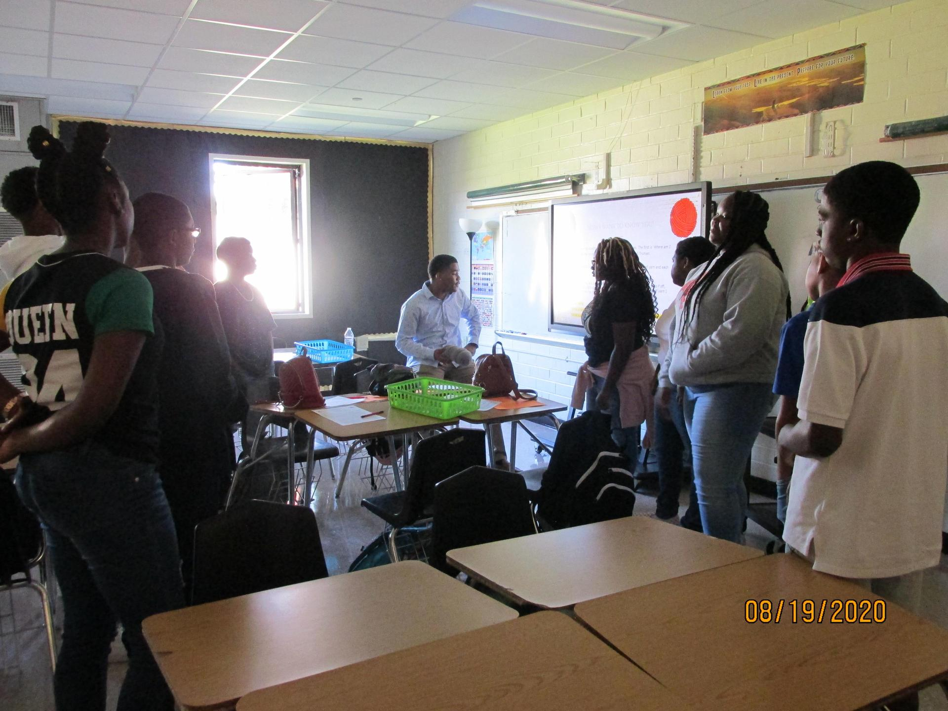 Students in the classroom with the teacher