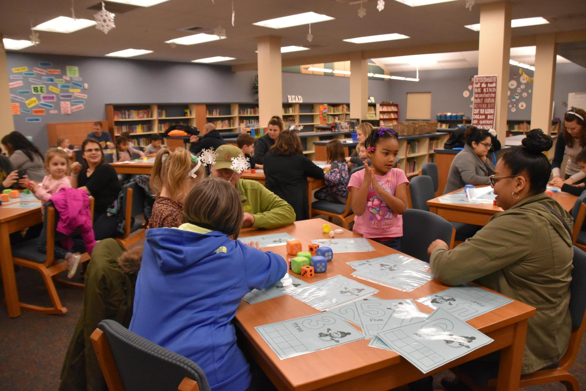 Families engaging in fun math lessons at our Pre-K Family Night.
