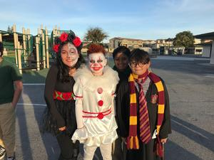 three students dressed in costume
