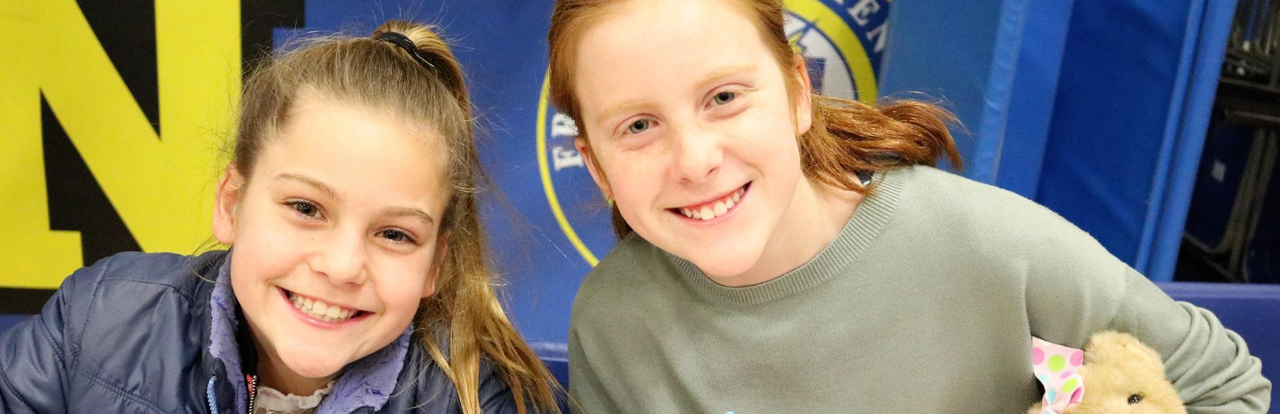 Photo of two sisters at Franklin School participating in Community Service Night activities.