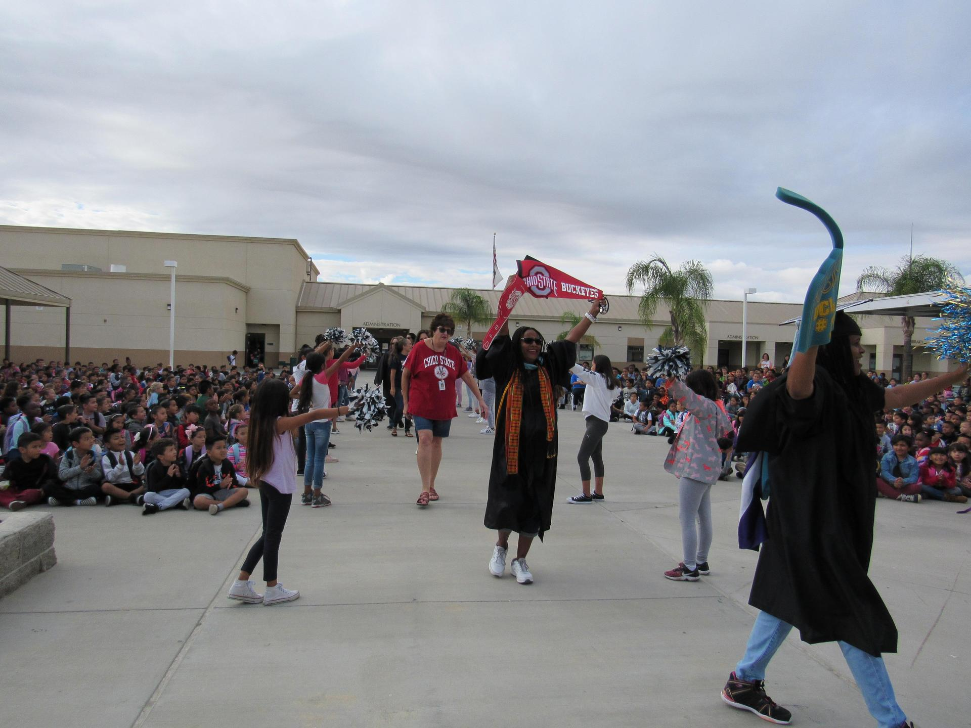 Staff and students hold a College Kick Off Parade at Towngate Elementary School