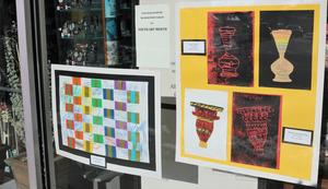 Photo of student artwork in Westfield storefront. Shoppers in downtown Westfield can enjoy art creations such as these during Youth Art Month in March, when paintings, drawings, and sculpture designed by approximately 330 students from Westfield's 10 public schools are on display in merchants' windows.