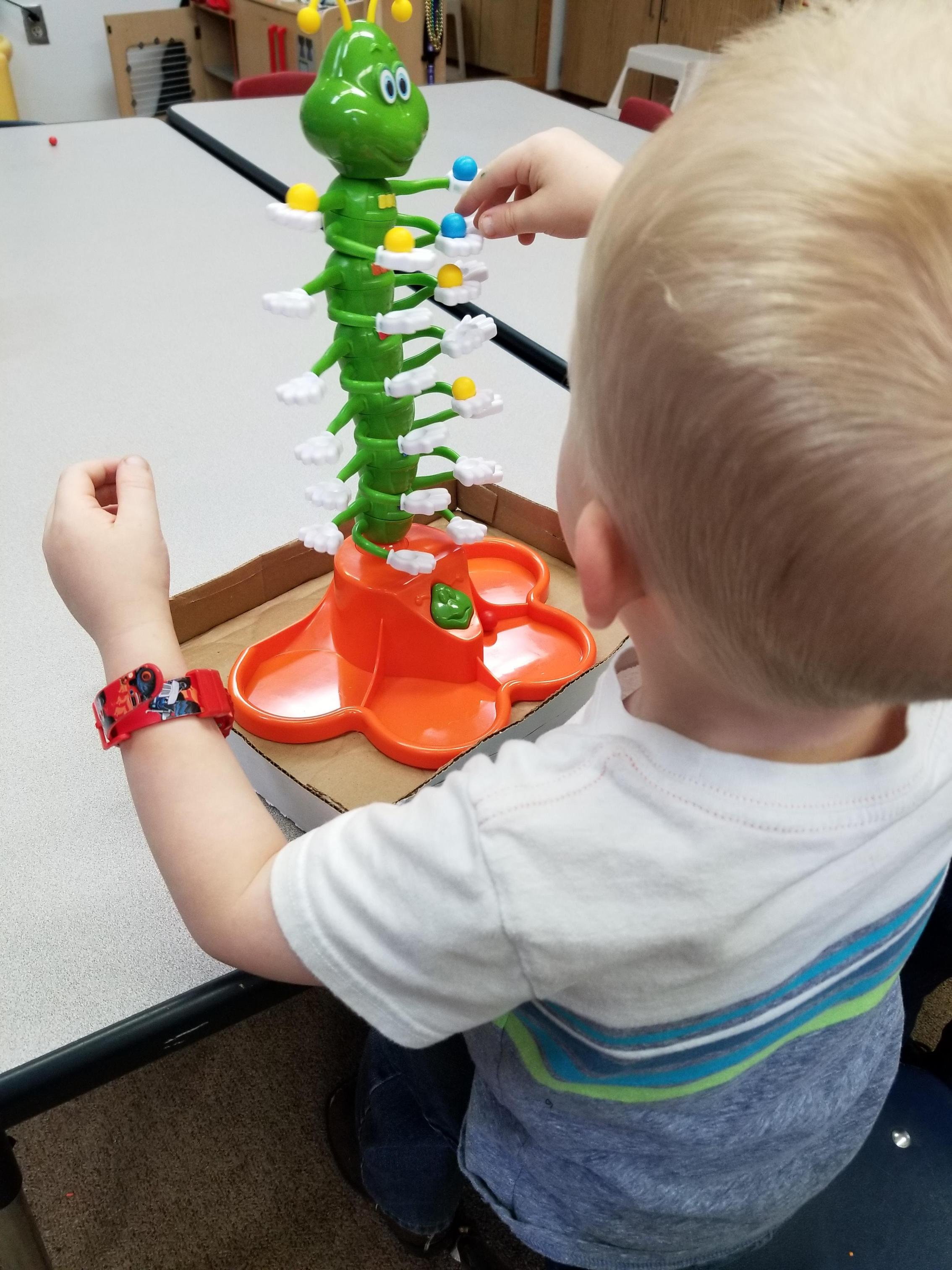 Balancing Caterpillar Game