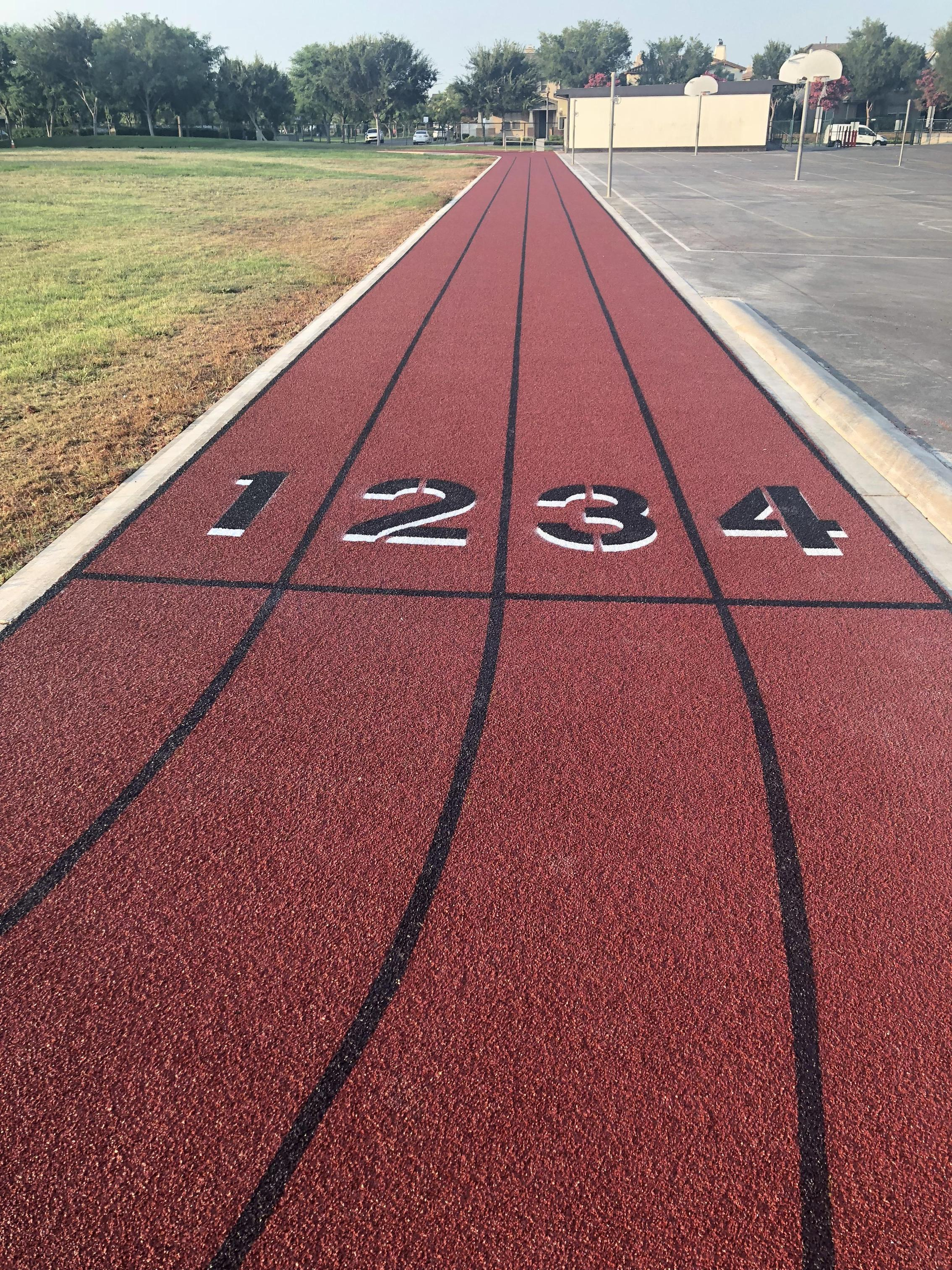 The new track surface is in at Fisler...time to get some exercise!
