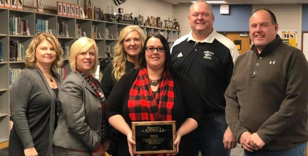 Board of Education presents service award to Tricia Wirth for her years of service on the School Board