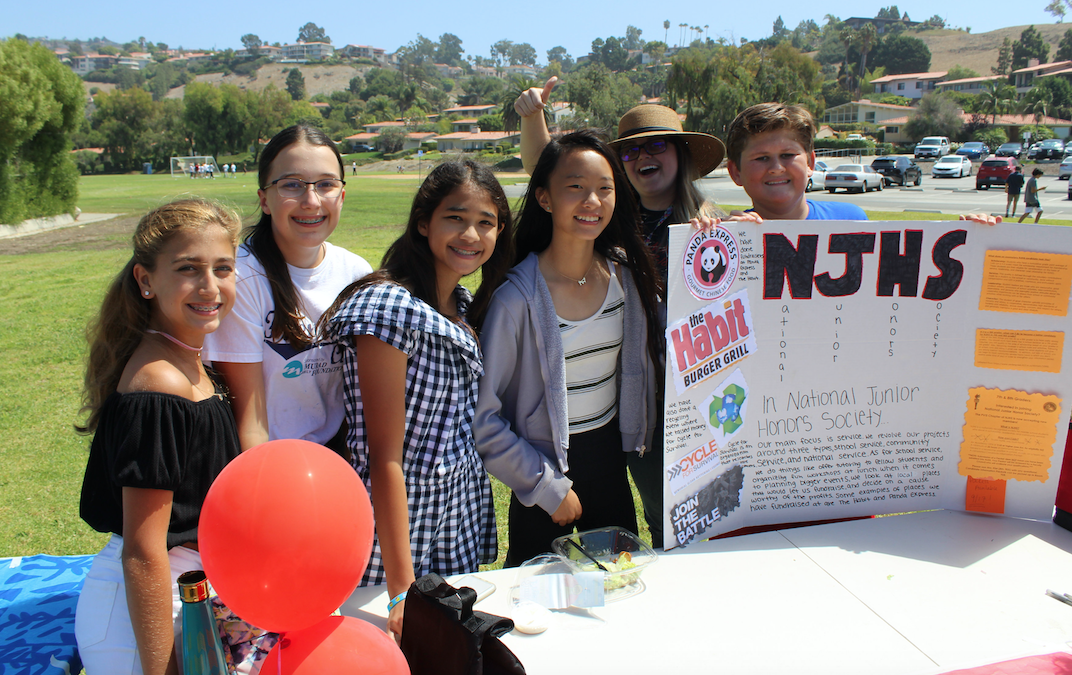 NJHS Students holding poster