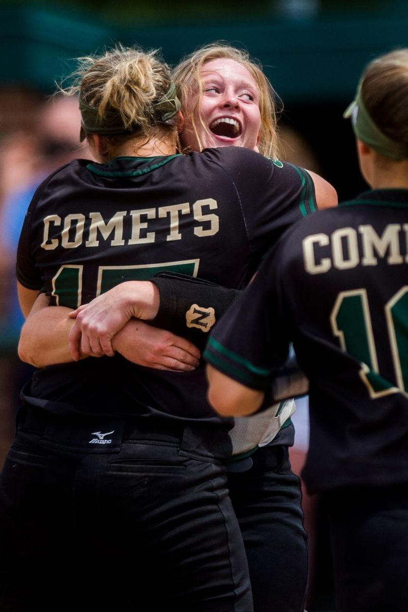 Coloma catcher Morgan Wagner, back, smiles as her teammate Mya Potter leaps into her arms celebrating the 5-1 victory over Clinton on Friday, June 15, 2018 at Michigan State University's Secchia Stadium in East Lansing.