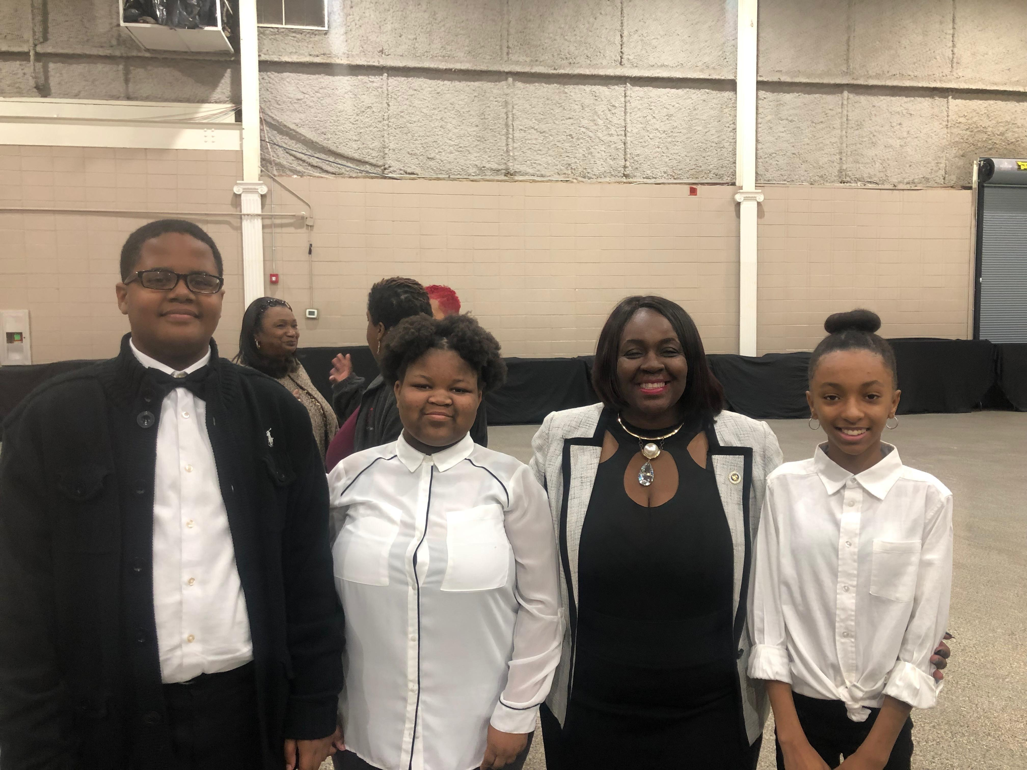 Photo of the Baker Middle School Choral Ensemble with State Representative Regina Barrow