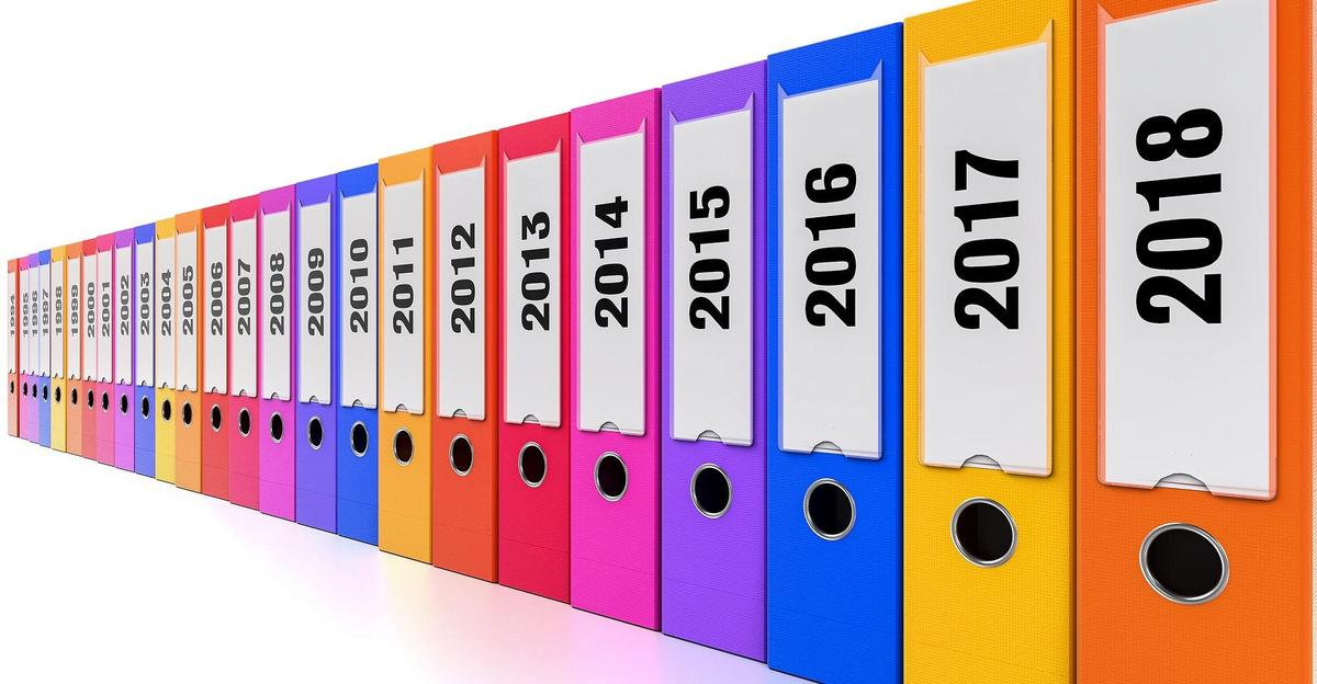 Photo of 3-ring binders categorized by year