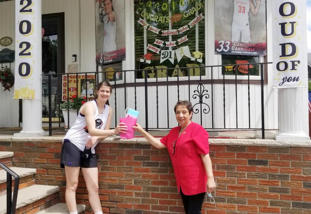 Student and educator in front of student's decorated front porch