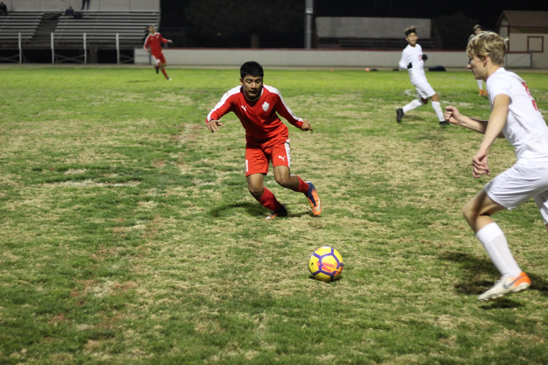 Cristobal Galvan running after the ball