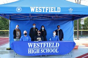 WHS senior Christopher Ho will play baseball at University of Maryland, Baltimore County next fall.   FR/LR:  Coach Bob Brewster, Christopher Ho, Coach Brian Sloan; BR/LR:  WHS Principal Mary Asfendis, Mr. and Mrs. Ho, Supervisor of Athletics Sandra Mamary