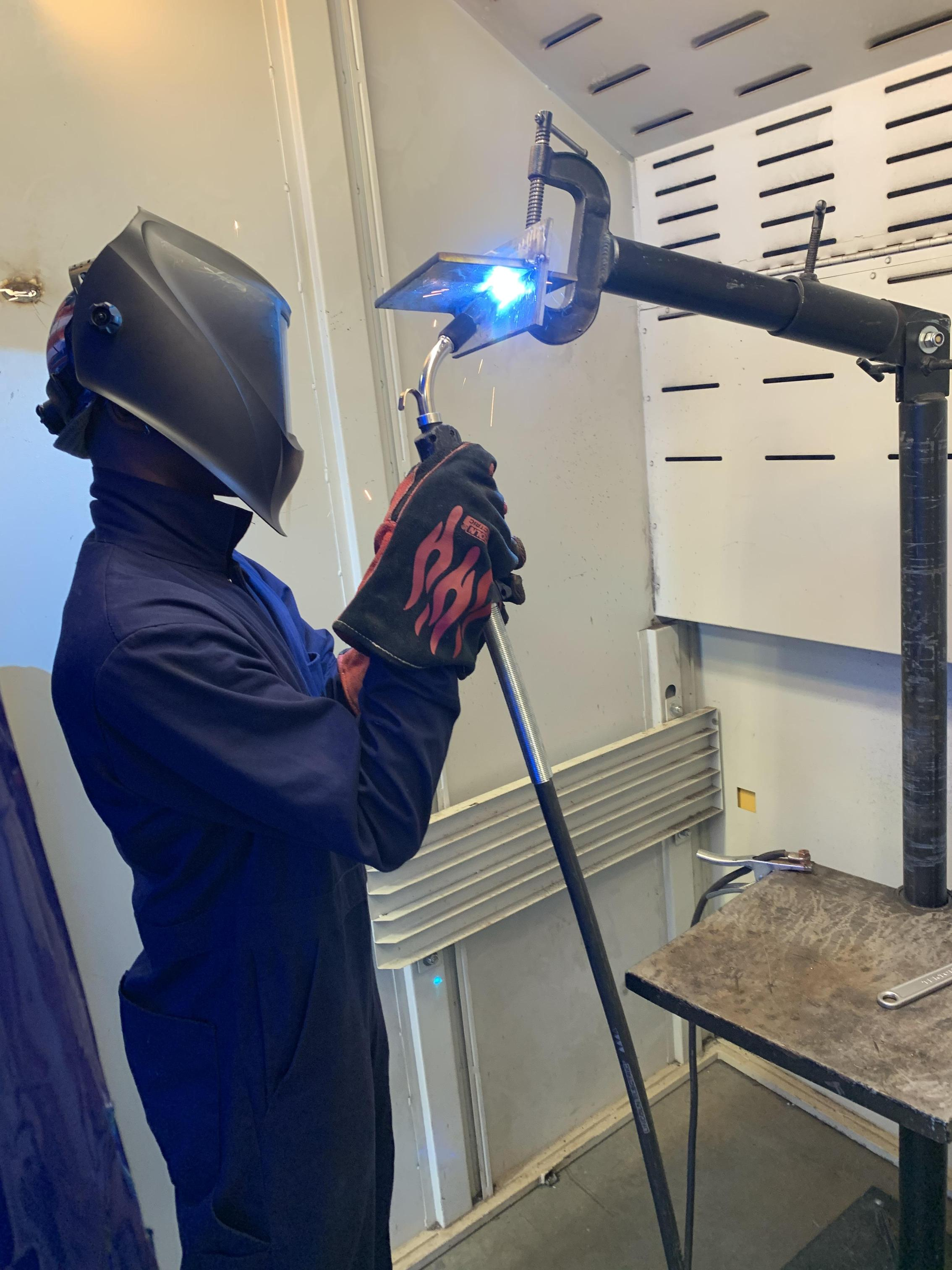 Students using the welding torch