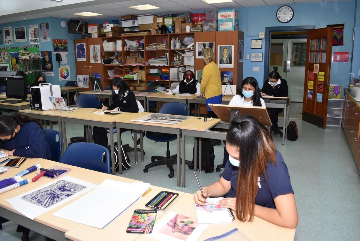 Students wearing masks, while working in the Art Studio