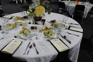 Table with salads and desserts