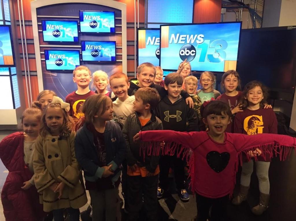 WLOS visit, students at an anchor desk