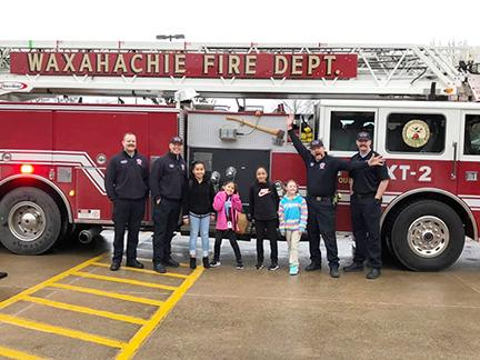 Wedgeworth Elementary students pose with firefighters and firetruck