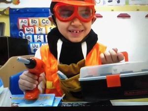 boy wearing orange construction costume