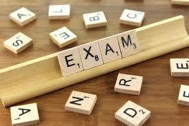 Scrabble tiles that spell out exam