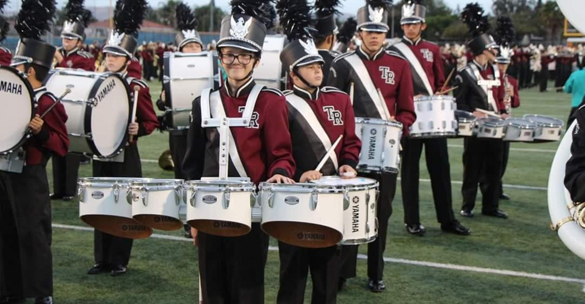 Drummer smiling.