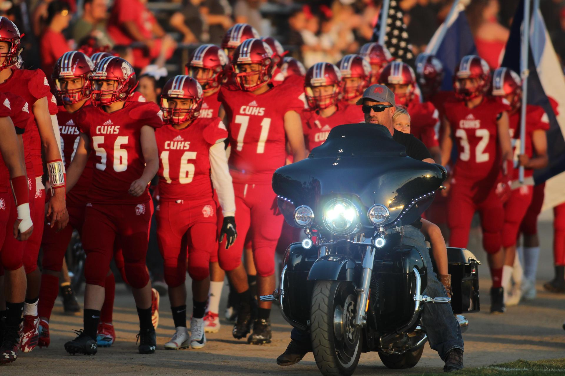 all red uniform football walk in