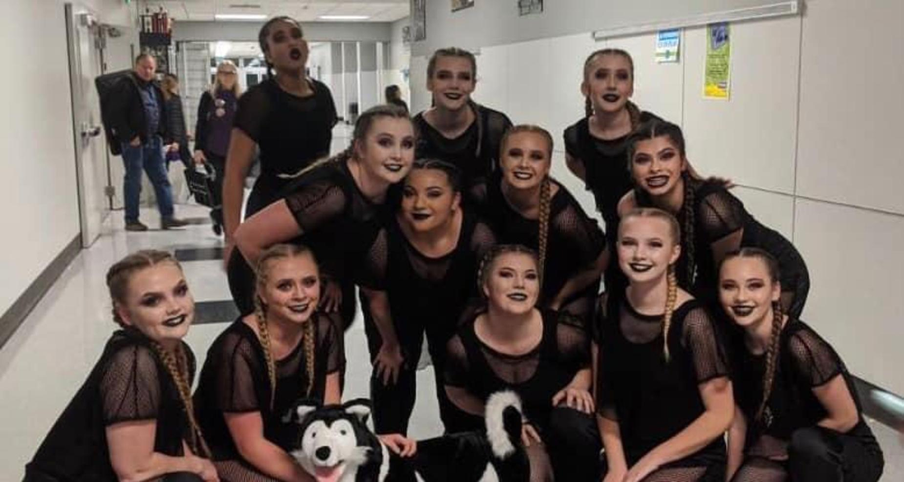 Dance team with Husky.