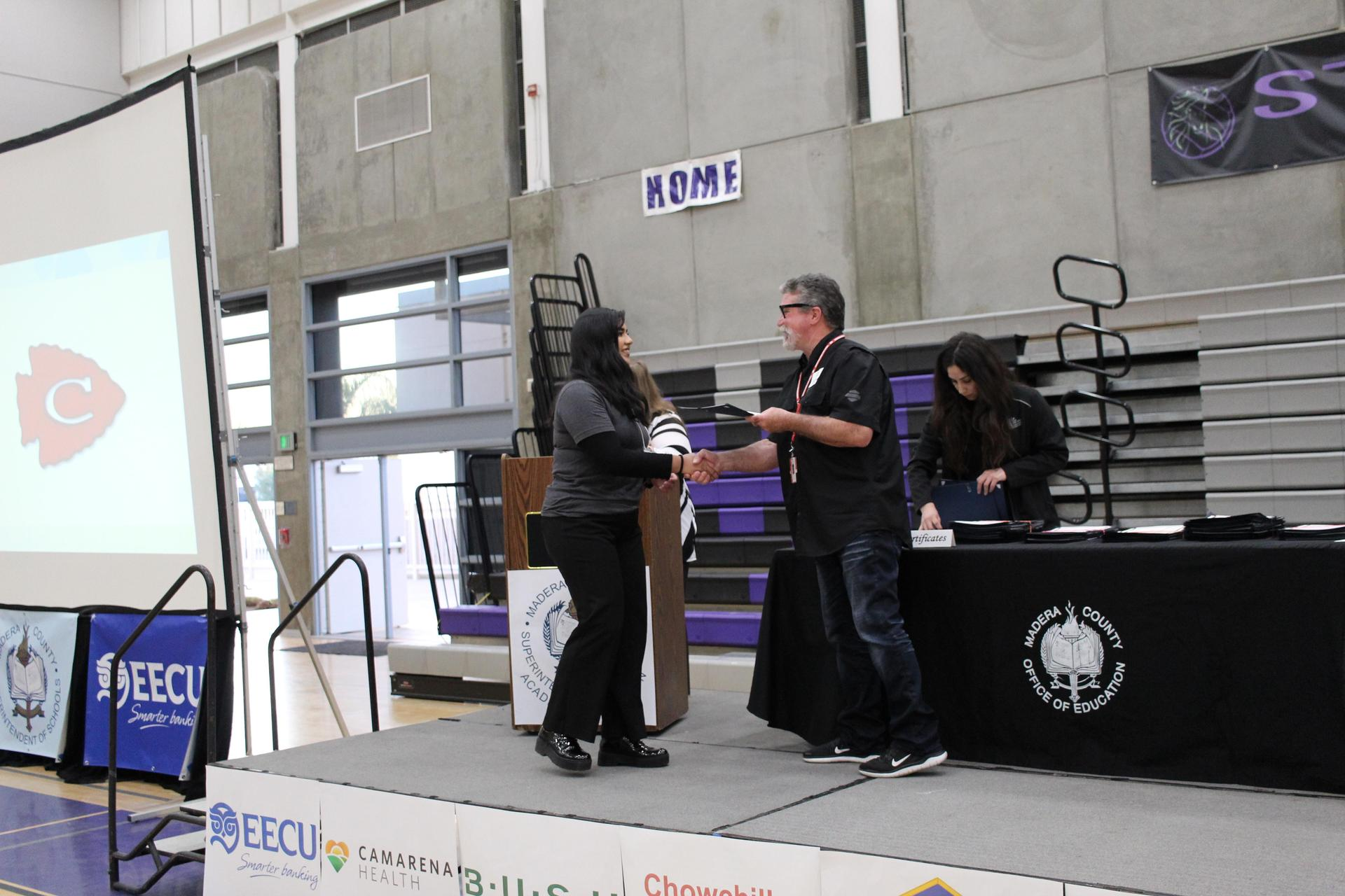Yadira Ortiz Camacho gets participation award from CUHSD Superintendent Ron Seals