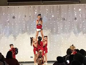 Cheerleaders forming pyramid at Talent Show.