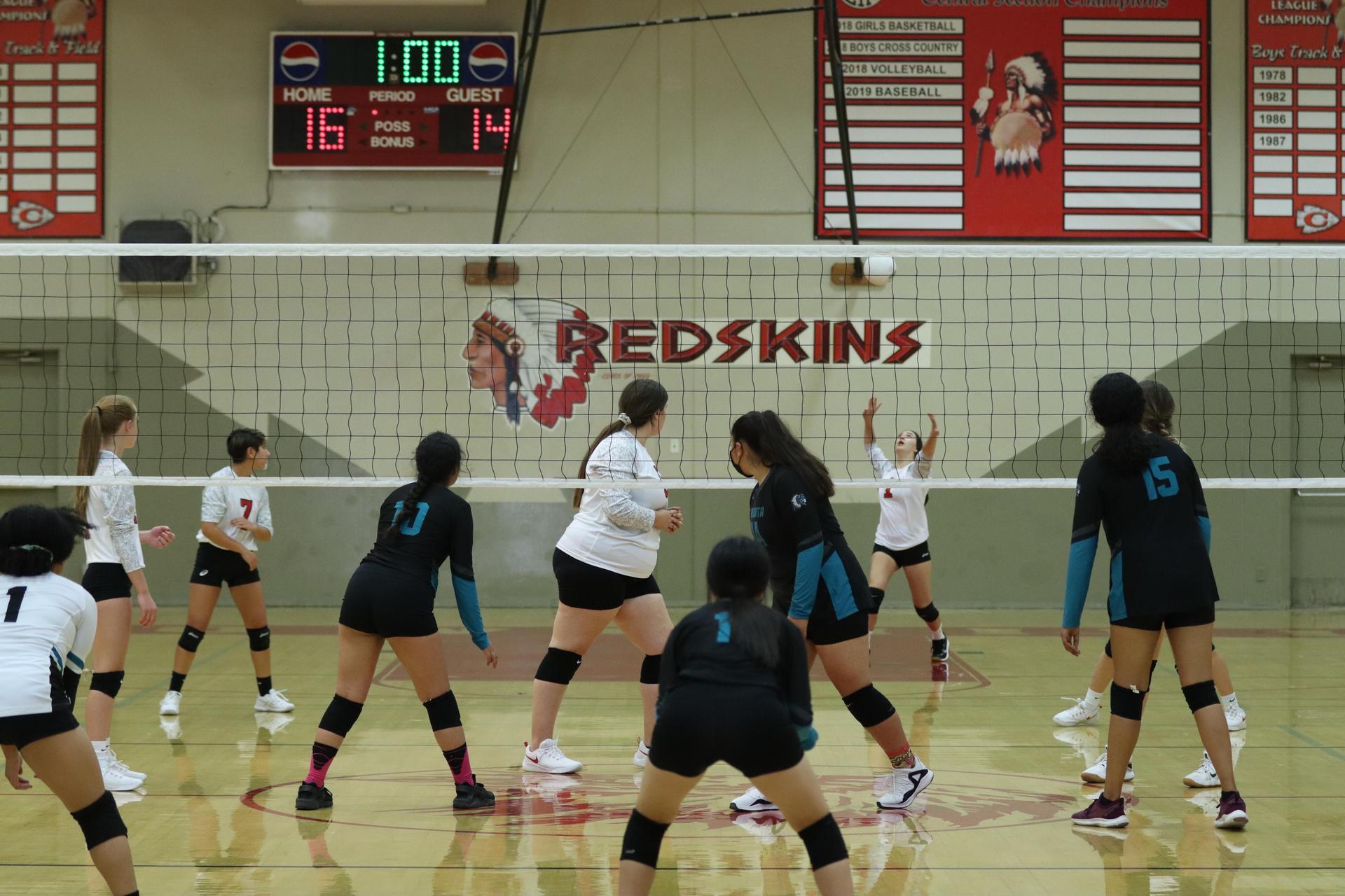 JV girls playing volleyball against Mendota