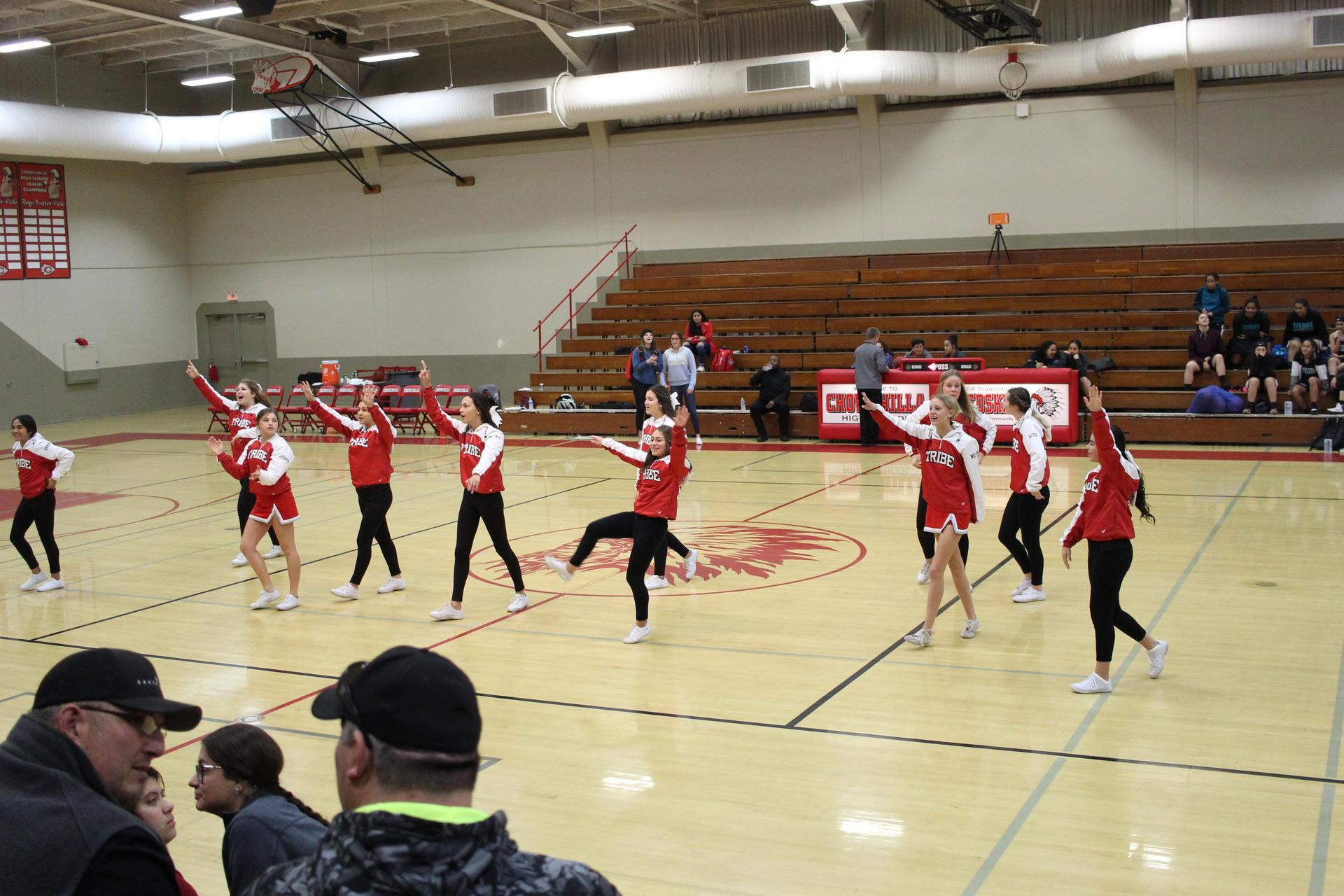 Cheer at Orange Cove basketball game.