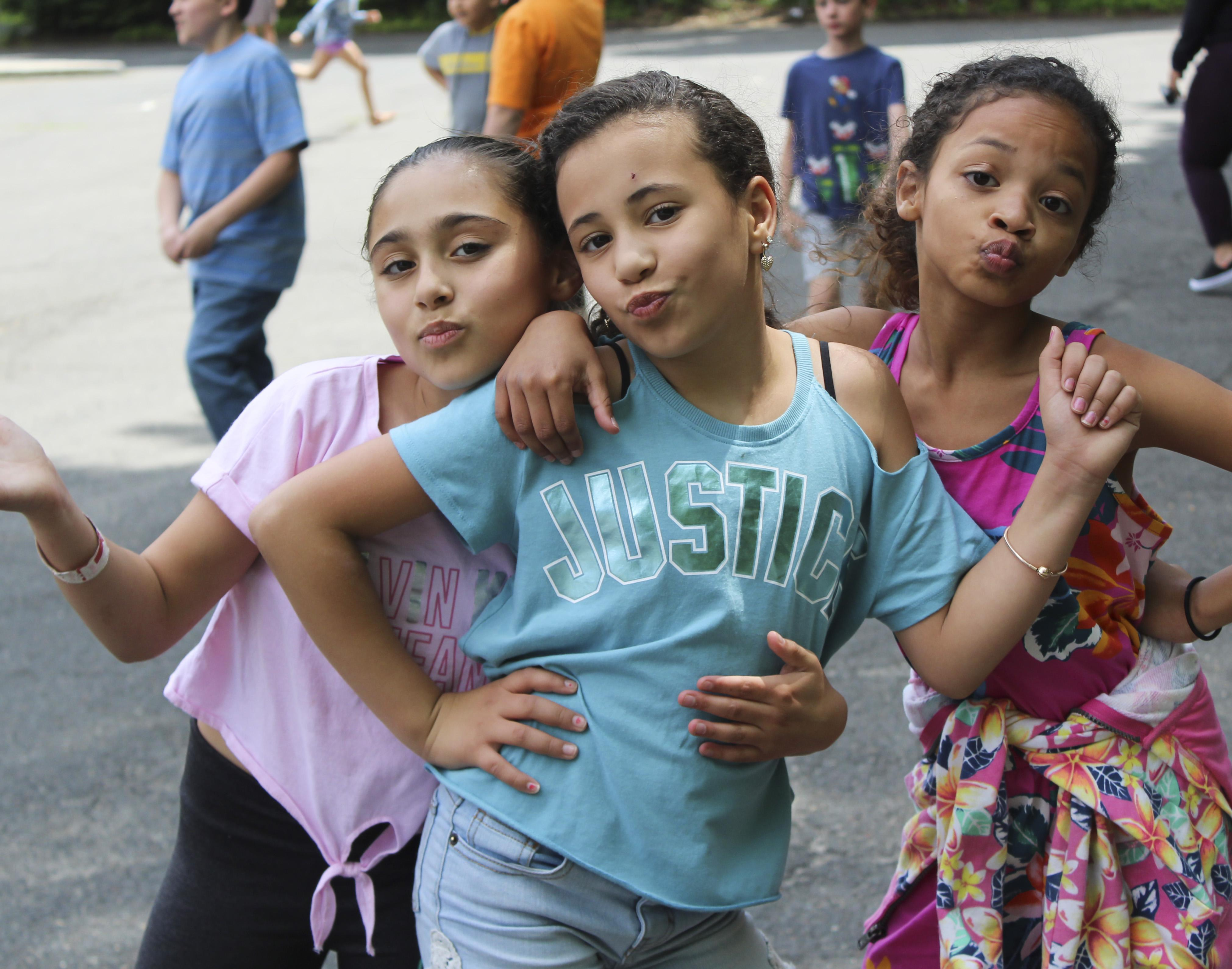 Three Andrew Avenue girls posing on playground