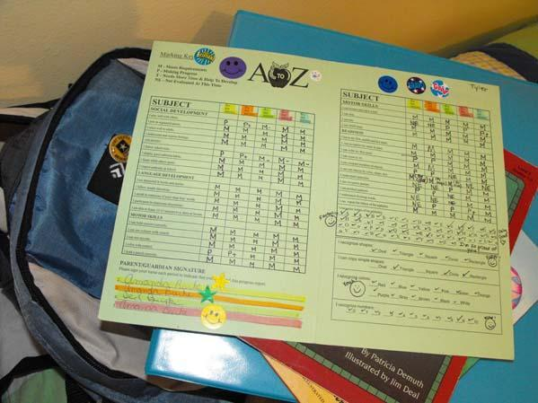 Picture of report card with lots of stickers