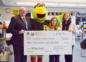 "Mars Area teacher Colleen Hinrichsen (second from right) is presented with a $1,000 grant to benefit her STEAM classrooms as part of her recognition as an ""All-Star Teacher."" Also pictured are Dr. Wesley Shipley, Superintendent; the Pirate Parrot; and Kara Eckert, Director of Curriculum, Instruction & Innovative Practices."