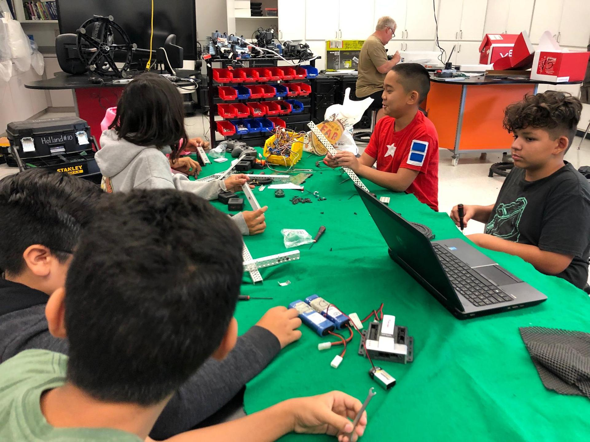 student working on vex robot 4