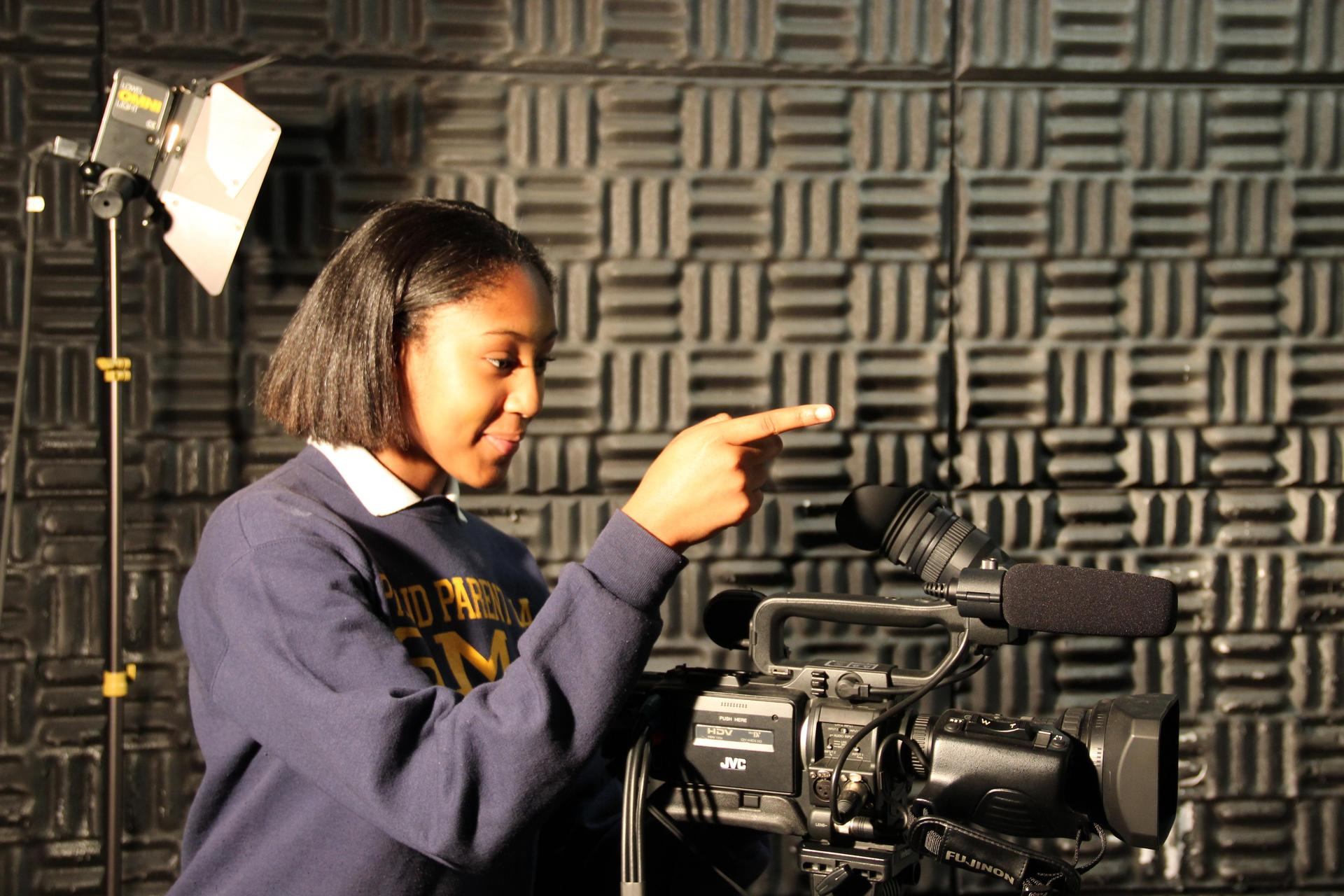 student using a professional camera