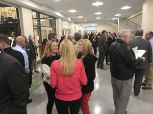 Guests filled the main hall of the Innovation Center before start of dedication event.