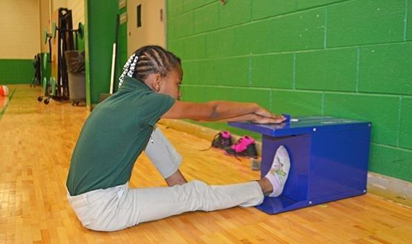 Student completing fitness test