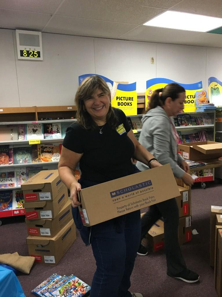 mom helping to load boxes at Book Fair