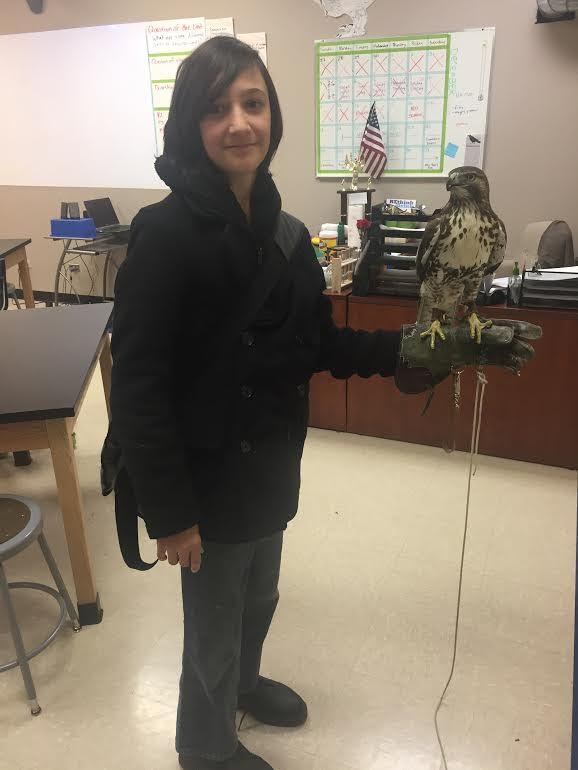Dr. Jennifer Campbell Smith shares her Hawk with students in her classes