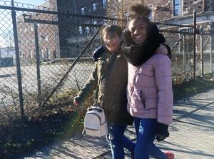Two fourth-graders walk to McLevy Green Tuesday morning.