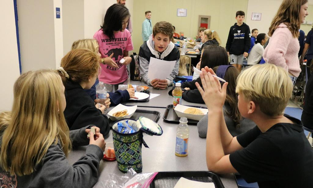 Photo of Roosevelt students talking together during lunch at Mix It Up Day.