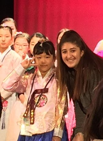 VAAS student taking a photo with Korean Elementary student