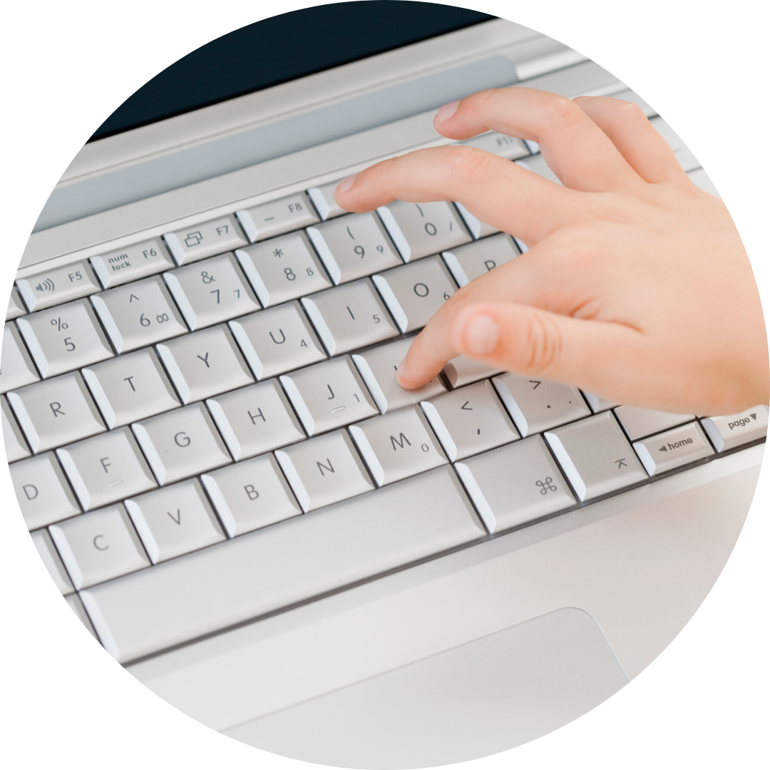 child's hand on keyboard