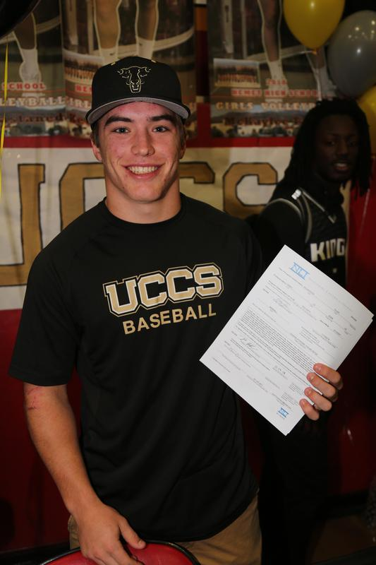 Tyler Richardson holding his Letter of Intent