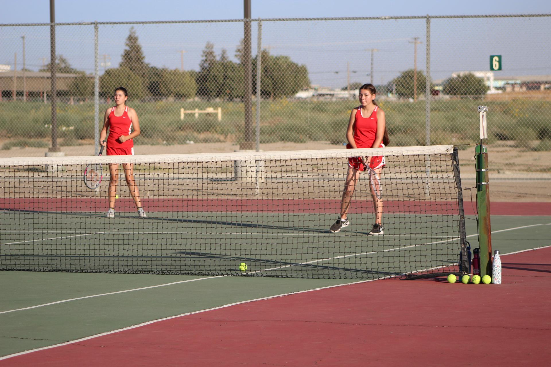 Girls playing tennis against Kerman