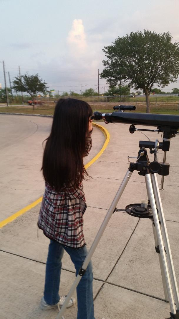 Students viewing through telescope.